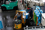 A worker transports ice on a turret truck at the new Tokyo Metropolitan Central Wholesale Market which opened in Toyosu on October 11, 2018, Tokyo, Japan. The new fish market replaces the famous Tsukiji Fish Market which closed for the last time on Saturday 6th October. The move to Toyosu was delayed for almost 2 years because of fears over toxins found in water below the new market. (Photo by Rodrigo Reyes Marin/AFLO)