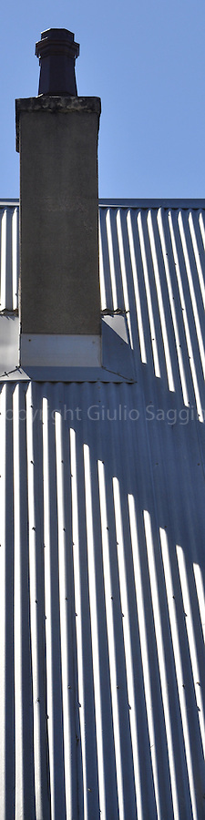 The shadow of a chimney falls across the corrugated iron roof of a house in the inner-Sydney suburb of Paddington.
