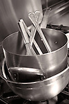 Stainless steel kitchen equipment–bowl, stock pot, whisk, utensils.