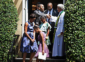 United States President Barack Obama shakes the hand of Reverand Luis Leon (R) while leaving with first lady Michelle Obama (L) and their daughters Malia (2L) and Sasha (3R) from St. John's Protestant Episcopal Church for the White House July 17, 2011 in Washington, DC.  The First Family attended Sunday services..Credit: Brendan Smialowski / Pool via CNP
