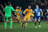 Jazzi Barnum-Bobb of Newport County gets between his goalkeeper Joe Day and Matthew Bloomfield of Wycombe Wanderers during the Sky Bet League 2 match between Newport County and Wycombe Wanderers at Rodney Parade, Newport, Wales on 22 November 2016. Photo by Mark  Hawkins.