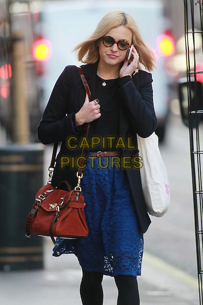 Fearne Cotton arriving at the studios of BBC Radio 1, London, England..October 20th, 2011.half length black tights blue lace skirt coat red bag purse sunglasses shades talking on mobile phone.CAP/HIL.©John Hillcoat/Capital Pictures.