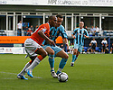 Taiwo Atieno of Luton and Josh Coulson of Cambridge United battle for possession during the Blue Square Bet Premier match between Luton Town and Cambridge United at Kenilworth Road, Luton  on 11th September 2010.© Kevin Coleman 2010