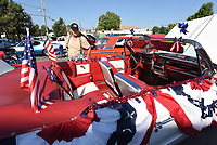 NWA Democrat-Gazette/FLIP PUTTHOFF <br /> PATRIOTIC RIDE<br /> Don Lipford of Springdale looks over a 1962 Buick Invicta decked out in red, white and blue Saturday July 7 2018 at the monthly Coffee and Cars event in downtown Springdale. Dale McFarlan of Fayetteville owns the car. Coffee and Cars takes place the first Saturday of the month April through October along Emma Avenue south of Shiloah Square. There's no charge for vehicle owners to enter the car show, and people can vote for their favorite cars and trucks. Winners get plaques, said Jennifor Joyner with Downtown Springdale Alliance.
