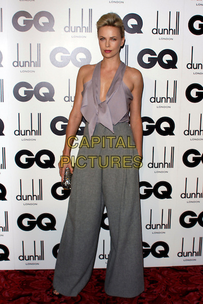 CHARLIZE THERON.GQ Men Of The Year Awards 2011 arrivals, Royal Opera House, London, England..September 6th, 2011.full length purple lilac sleeveless top blouse grey gray wide leg flared trousers hand in pocket.CAP/COA/CC.©CC/COA/Capital .