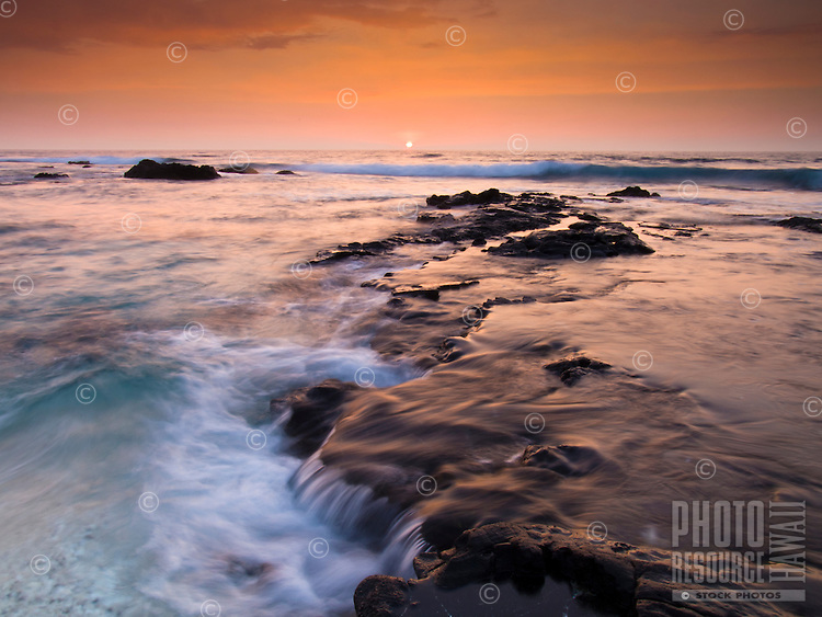 A golden sunset from Pine Trees Beach on the Big Island.
