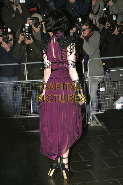 DITA VON TEESE.The Shockwaves NME Awards 2005,.Hammersmith Palais, Shepherds Bush Road,.London, February 17th 2005..full length purple dress sheer see-through thru see through black cape shoulders arm jewellery back behind rear Heather Sweet  .Ref: AH.www.capitalpictures.com.sales@capitalpictures.com.?Capital Pictures.