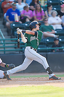 Ryder Jones (15) of the Augusta GreenJackets follows through on his swing against the Hickory Crawdads at L.P. Frans Stadium on May 11, 2014 in Hickory, North Carolina.  The GreenJackets defeated the Crawdads 9-4.  (Brian Westerholt/Four Seam Images)