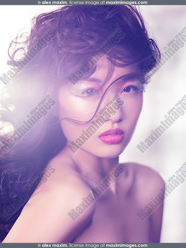 Expressive beauty portrait of an asian woman with artistic makeup