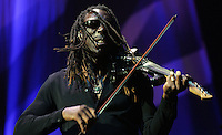 Hair flies as violinist Boyd Tinsley works his instrument during the sold-out Dave Mathews Band concert at the John Paul Jones Arena Friday in Charlottesville, VA.