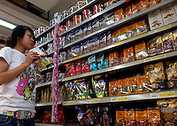Cadbury and Le conte chocolates are on sale in a Carrefour supermarket in Beijing, China. Major international chains like Carrefour and Walmart Stores have expanded aggressively in China. Local Chinese retailers have loudly protested this and lobbied heavily for protection from the new competition in price and service that these major retailers have set off..23 Jul 2006