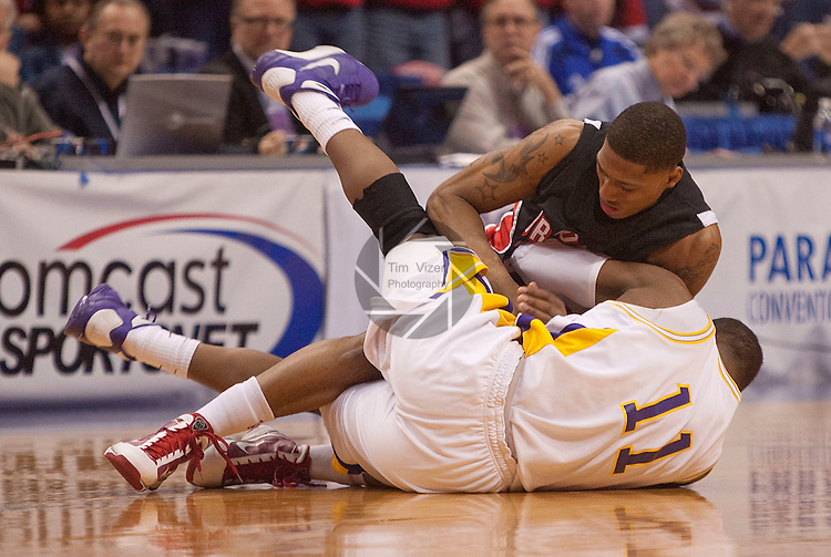 March 6,  2010           Northern Iowa guard Kwadzo Ahelegbe (11) and Bradley guard Chris Roberts (23) scramble on the court floor for a loose ball (hidden, between them) in the second half.   The University of Northern Iowa defeated Bradley University by a score of 57-40 in the first of two semifinals on Saturday March 6, 2010 at Missouri Valley Conference Tournament held at the Scottrade Center in downtown St. Louis.