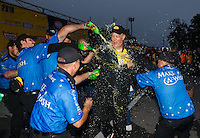 Oct 2, 2016; Mohnton, PA, USA; NHRA funny car driver Tommy Johnson Jr celebrates with crew members after winning the Dodge Nationals at Maple Grove Raceway. Mandatory Credit: Mark J. Rebilas-USA TODAY Sports
