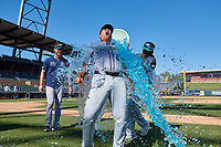 Salt River Rafters infielder Vidal Brujan (33) splashes water on manager Keith Johnson (21) after winning the Arizona Fall League Championship Game against the Surprise Saguaros on October 26, 2019 at Salt River Fields at Talking Stick in Scottsdale, Arizona. The Rafters defeated the Saguaros 5-1. (Zachary Lucy/Four Seam Images)
