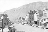 &quot;Main Ave. and Business District - Durango, Colo.  Smelter Hill in background.&quot;<br /> Durango, CO  Taken by Sanborn, Harold - ca 1938