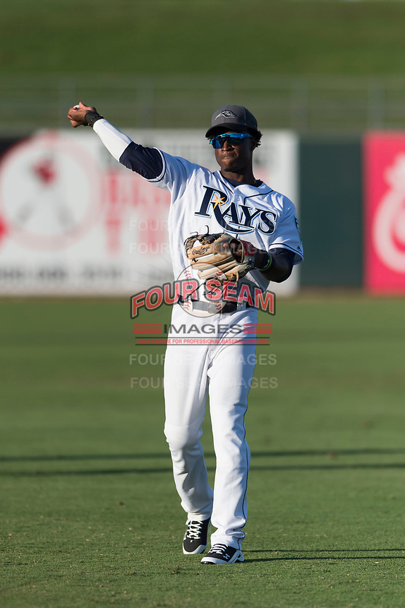 AFL West shortstop Lucius Fox (5), of the Peoria Javelinas and Tampa Bay Rays organization, throws in the outfield before the Arizona Fall League Fall Stars game at Surprise Stadium on November 3, 2018 in Surprise, Arizona. The AFL West defeated the AFL East 7-6 . (Zachary Lucy/Four Seam Images)