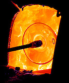 Murano, Italy - March 25, 2006 -- Molton glass that is being shaped into a bowl is heated in a blast furnace to keep it soft and malleable in Murano, Italy on March 25, 2996..Credit: Ron Sachs / CNP