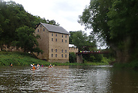 NWA Democrat-Gazette/FLIP PUTTHOFF<br /> Paddlers pass an historic grist mill on the Turkey River July 26 2015 during the first day of the Great River Rumble.