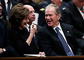 Former President George W. Bush smiles with former first lady Laura Bush during the State Funeral for former President George H.W. Bush at the National Cathedral, Wednesday, Dec. 5, 2018, in Washington.<br /> Credit: Alex Brandon / Pool via CNP