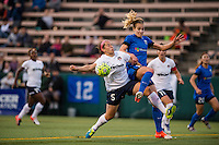 Seattle, Washington -  Sunday, September 11 2016: Washington Spirit defender Whitney Church (5) defends against Seattle Reign FC midfielder Beverly Yanez (17) during a regular season National Women's Soccer League (NWSL) match between the Seattle Reign FC and the Washington Spirit at Memorial Stadium. Seattle won 2-0.