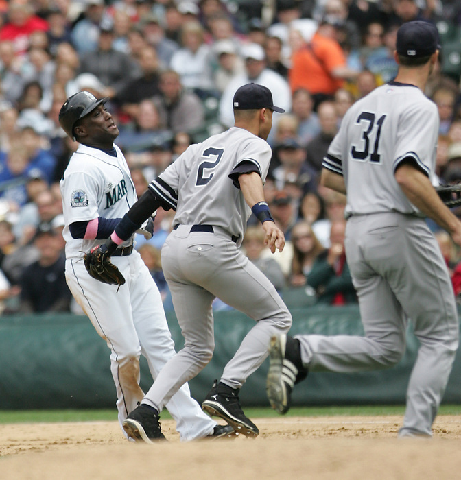 13 May 2007:Seattle Mariners #5 Yuniesky Betancourt gets himself in a pickle and is tagged out trying to get back to first by New York Yankees #2 Derek Jeter and #31 Josh Phelps during the  Seattle Mariners 2-1 win over the New York Yankees at Safeco Park in Seattle, Washington.
