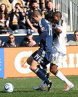Danny Mwanga#10 of the Philadelphia Union battles Greg Janicki#14 of the Vancouver Whitecaps for the ball during an MLS match at PPL Park in Chester, PA. on March 26 2011. Union won 1-0.