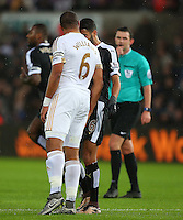 Riyad Mahrez of Leicester City and Ashley Williams of Swansea City clash during the Barclays Premier League match between Swansea City and Leicester City played at The Liberty Stadium on 5th December 2015