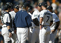 04 October 2009: Seattle Mariners manager Don Wakamatsu talks with starting pitcher Felix Hernadez and infield during the game against the Texas Rangers. Seattle won 4-3 over the Texas Rangers at Safeco Field in Seattle, Washington.