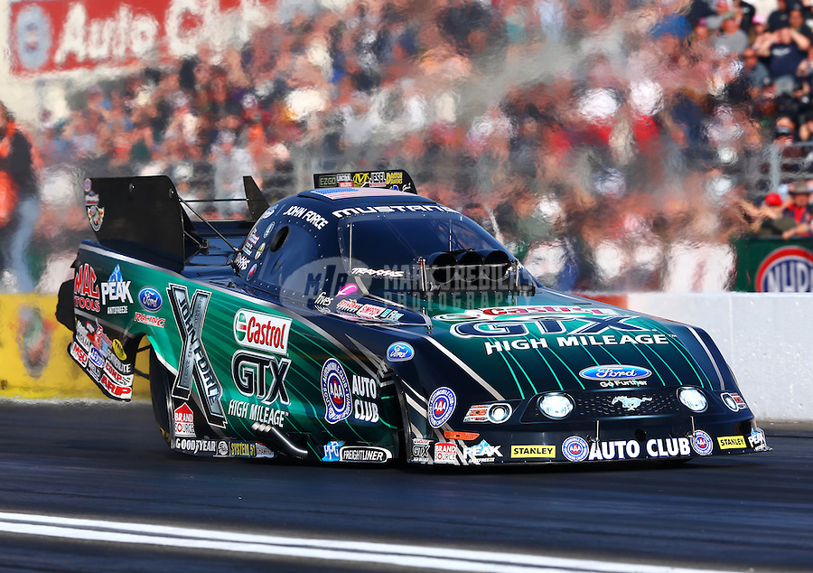 Feb 9, 2014; Pomona, CA, USA; NHRA funny car driver John Force during the Winternationals at Auto Club Raceway at Pomona. Mandatory Credit: Mark J. Rebilas-