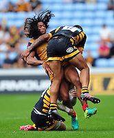 Thretton Palamo of Bristol Rugby is double-tackled by Elliot Daly and Frank Halai of Wasps. Aviva Premiership match, between Wasps and Bristol Rugby on September 18, 2016 at the Ricoh Arena in Coventry, England. Photo by: Patrick Khachfe / JMP