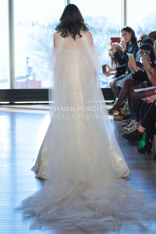 """Model Helen walks runway in a """"Priscilla"""" bridal gown from the Rivini Spring Summer 2017 bridal collection by Rita Vinieris at The Standard Highline Room, during New York Bridal Fashion Week on April 15, 2016."""