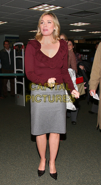 "KIM CATTRALL .Signs copies of her new book, ""Sexual Intelligence"" at the Barnes & Noble Bookstore on 5th Avenue in Manhattan, New York, New York ..October 26th, 2005.Photo Credit: Jackson Lee/AdMedia/Capital Pictures.Ref: JL/ADM.full length burgundy brown top greygray skirt fist.www.capitalpictures.com.sales@capitalpictures.com.© Capital Pictures."