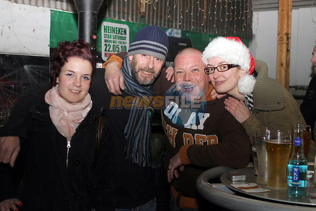 Bea Igajev, Shane Gartland, Mark Keegan and Karen Leech on Christmas Eve in McPhails. ..(Photo credit should read Jenny Matthews www.newsfile.ie)....This Picture has been sent you under the conditions enclosed by:.Newsfile Ltd..The Studio,.Millmount Abbey,.Drogheda,.Co Meath..Ireland..Tel: +353(0)41-9871240.Fax: +353(0)41-9871260.GSM: +353(0)86-2500958.email: pictures@newsfile.ie.www.newsfile.ie.