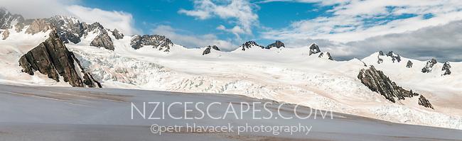 Vast snowfields near Mackay Rocks with orange dust, Westland National Park, West Coast, Westland Tai Poutini National Park, World Heritage Area, New Zealand