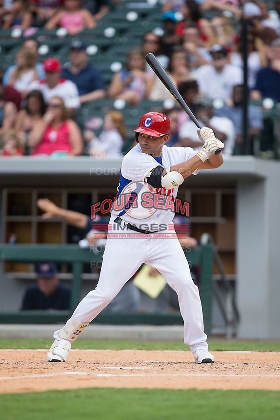 Frederich Cepeda Cruz (24) of the Cuban National Team at bat against the US Collegiate National Team at BB&T BallPark on July 4, 2015 in Charlotte, North Carolina.  The United State Collegiate National Team defeated the Cuban National Team 11-1.  (Brian Westerholt/Four Seam Images)