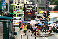 Des Voeux Road on the north shore of Hong Kong Island is shared between motor traffic and the tramway. Tram tracks run in the middle of the road while a designated bus lane also runs along the road for most of its length..