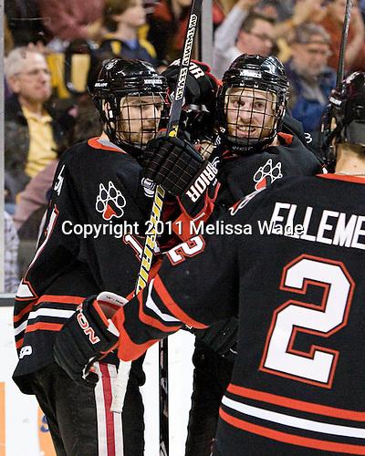 Steve Silva (Northeastern - 17), Tyler McNeely (Northeastern - 94) - The Boston College Eagles defeated the Northeastern University Huskies 5-4 in their Hockey East Semi-Final on Friday, March 18, 2011, at TD Garden in Boston, Massachusetts.