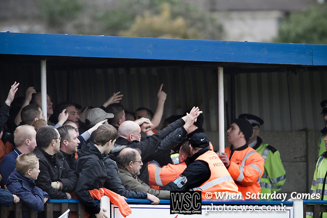 Wealdstone 0 Newport County 0, 17/03/2012. St Georges Stadium, FA Trophy Semi Final. Stewards trying to intervene to prevent spectators from fighting behind the goal at St Georges Stadium, home ground of Wealdstone FC, as the club played host to Newport County (yellow) in the semi-final second leg of the F.A. Trophy. The game ended in a goalless draw, watched by a capacity crowd of 2,092 which meant the visitors from Wales progressed by three goals to one to the competition's final at Wembley, where they would meet York City. The F.A. Trophy was the premier cup competition for non-League clubs in England and Wales affiliated to the Football Association. Photo by Colin McPherson.