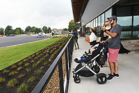 NWA Democrat-Gazette/FLIP PUTTHOFF <br />Brittany and Nathan Jones of Bentonville, with their 8-month-old son, Camden, watch aircraft take off and land Saturday Oct. 6 2018 during the grand opening of Thaden Fieldhouse at the Bentonville airport. The fieldhouse features an exhibit hangar, porches that overlook the runway, a cafe and retail shop. It is also home of the OZ1 Flying Club.