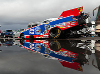 Feb 22, 2019; Chandler, AZ, USA; The car of NHRA funny car driver Robert Hight reflects in a rain puddle as the car is towed to the staging lanes during qualifying for the Arizona Nationals at Wild Horse Pass Motorsports Park. Mandatory Credit: Mark J. Rebilas-USA TODAY Sports