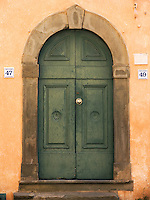 Entry door to house at the Comune di Capannori in village of Castelvecchio, Tuscany, Ital