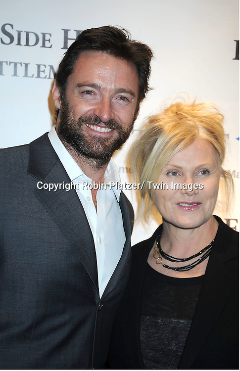 Hugh Jackman and wife Deborra-Lee Furness attending The 2011 Winter Antiques Show Opening Night on January 20, 2011 at The Park Avenue Armory in New York City. .