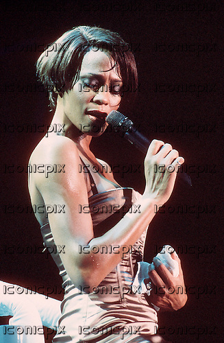Whitney Houston (Aug 9, 1963 - Feb 11, 2012)- performing live on the My Love Is Your Love World Tour at Wembley Arena in London UK - 16 Sep 1999.  Photo credit: George Chin/IconicPix