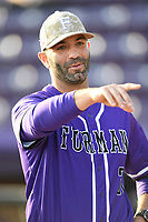 Head coach Brett Harker (31) of the Furman Paladins prior to the game against the UNC Asheville Bulldogs on Wednesday, February 27, 2019, at Latham Baseball Stadium on the campus of Furman University in Greenville, South Carolina. UNC Asheville won, 4-3. (Tom Priddy/Four Seam Images)