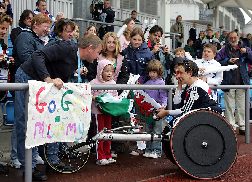 Photo: Paul Thomas..VISA Paralympic World Cup 2007. Athletics. 13/05/2007...Dame Tanni Grey-Thompson of Great Britain is greeted by her husband Ian (L) and daughter Carys after her final race before retirement.