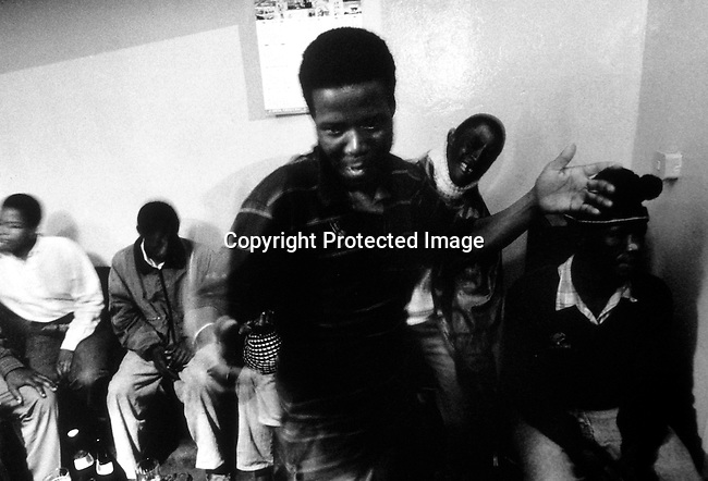 ditown00143 Unidentified people in a Shebeen, a (township bar) on April 22, 1997 in Soweto, South Africa. These shebeens are usually in someone's home where neighbors come to drink beer and watch sports on television. Party, dancing.Photo: Per-Anders Pettersson/ iAfrika Photos