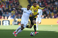 Luciano Narsingh of Swansea City is closely marked by Jose Holebas of Watford during the Premier League match between Watford and Swansea City at Vicarage Road Stadium, Watford, England, UK. Saturday 15 April 2017