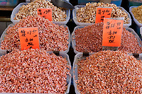 Bins of Chinese colorful dried shrimp in a shop in Chinatown, Vancouver, British Columbia, Canada