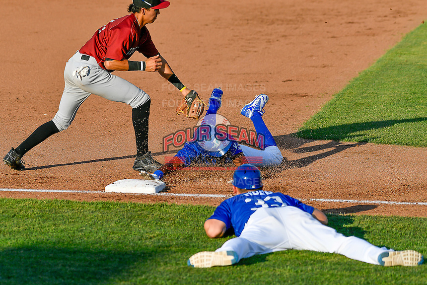 Errol Robinson (9) of the Ogden Raptors hustles towards third base against the Idaho Falls Chukars in Pioneer League action at Lindquist Field on June 28, 2016 in Ogden, Utah. The Raptors defeated the Chukars 12-11.  (Stephen Smith/Four Seam Images)