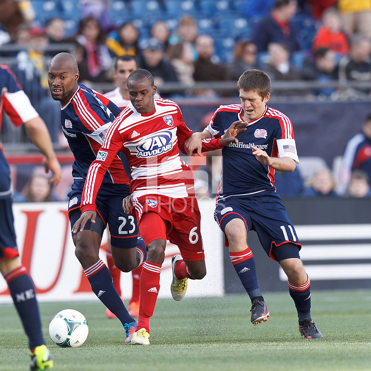 FC Dallas midfielder Jackson Goncalves (6) works to clear ball as New England Revolution defender Jose Goncalves (23) and New England Revolution substitute defender Kelyn Rowe (11) defend..  In a Major League Soccer (MLS) match, FC Dallas (red) defeated the New England Revolution (blue), 1-0, at Gillette Stadium on March 30, 2013.